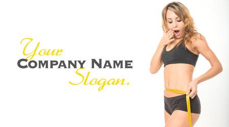 woman measuring waist: astonished slim woman measuring her waist Stock Photo
