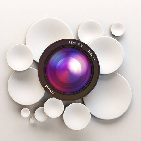 White disks and a camera lens Stock Photo - 27103184