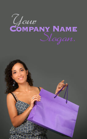 Young woman holding a shopping bag photo