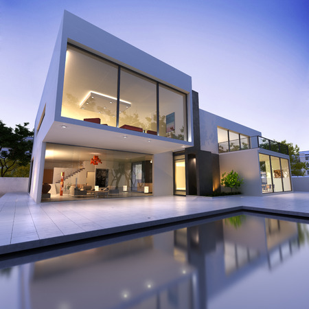 contemporary style: External view of a contemporary house with pool at dusk