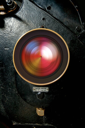 Lens embedded in a retro locomotive background photo