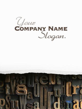 typescript: Torn white paper revealing vintage typescript letters Stock Photo
