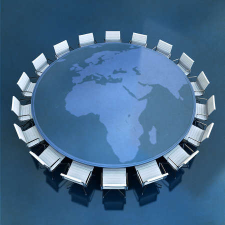 Round meeting table with the world map centered in Europe and Africa   photo