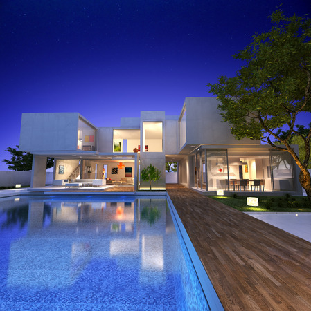 pool deck: External view of a contemporary house with pool at dusk