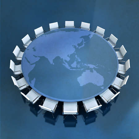 Round meeting table with the world map centered in Asia Stock Photo