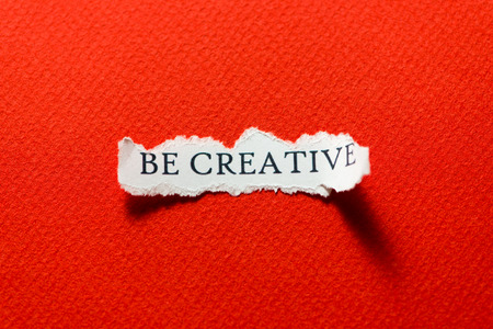 A scrap of paper with the motto, be creative