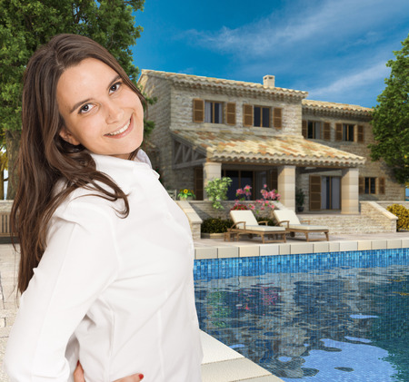 Young woman by a beautiful luxurious house with swimming pool photo