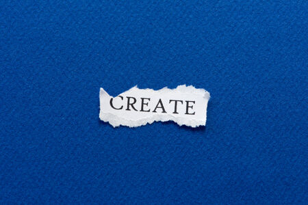 A scrap of paper with the word create Stock Photo - 28017800