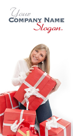 Happy young blonde in the process of receiving lots of red presents photo