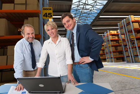 warehouse equipment: Business team in a transportation warehouse Stock Photo