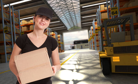 Smiling female worker in a distribution warehouse photo