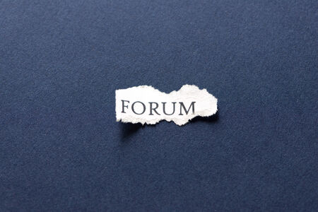 A scrap of paper with the word forum Stock Photo - 28141108