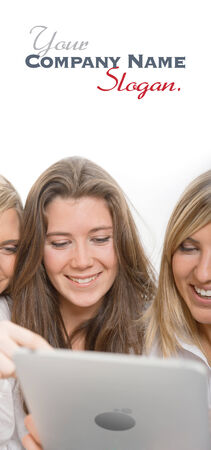 Group of amused girls around a pc tablet.  photo