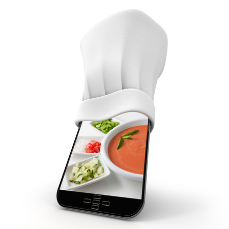 Tablet wearing a chefs toque with the picture of a home made gazapacho photo