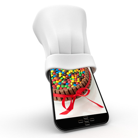 Tablet wearing a chefs toque with the picture of a colorful cake photo
