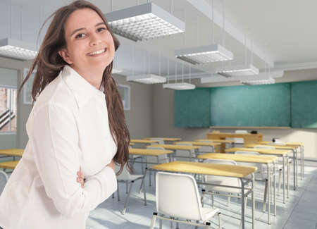 Smiling female  teacher in an empty classroom photo