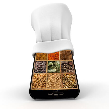 Tablet wearing a chefs toque with a spice collage in the screen photo