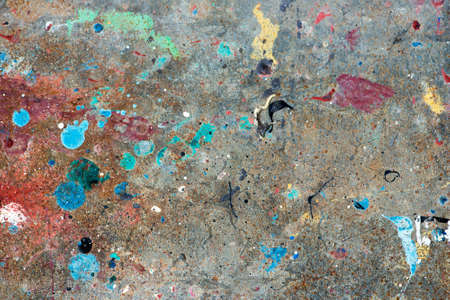 decadence: Concrete floor with multicolored paint stains Stock Photo
