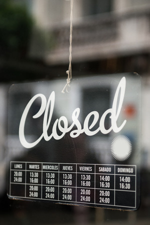 closed sign: Closed sign on a shop
