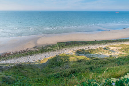 Beautiful Normandy beach, with remains of the Landing photo