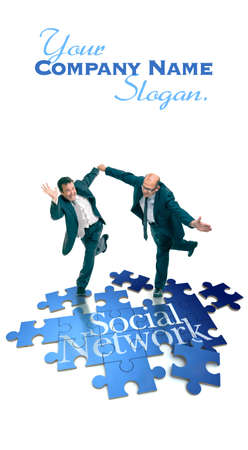 Humorous shot of a pair of running businessmen on a puzzle with the word social network photo