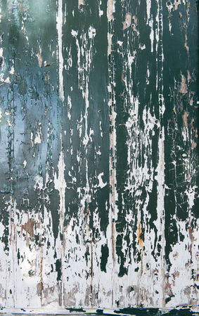 deteriorating: Old wooden surface with green paint peeling off