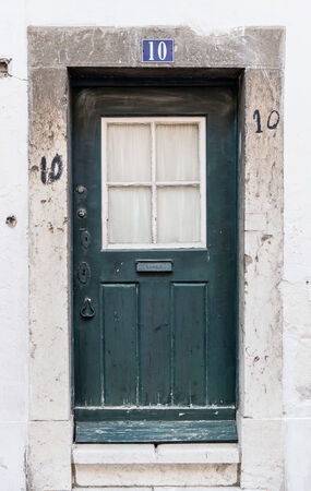 number 10: Old door with number 10 Stock Photo