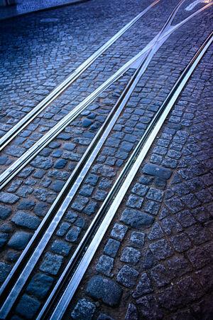 Tram rails on a cobblestone road photo