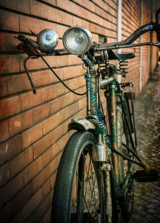 Vintage bicycle against a brick wall photo