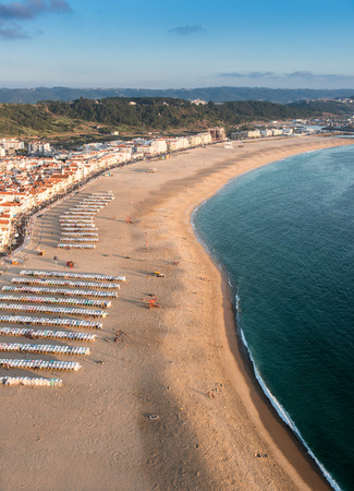 aereal: Beautiful Nazare beach in Portugal, taken from the cliffs