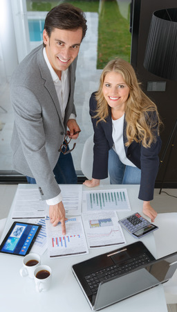 Man and woman in casual business clothes discussing business plan photo