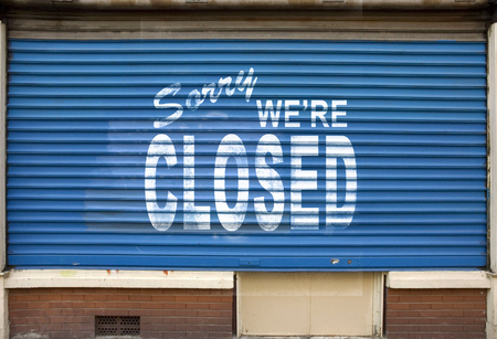 Shop with the blinds down and the sign, sorry we are closed Imagens - 34347408