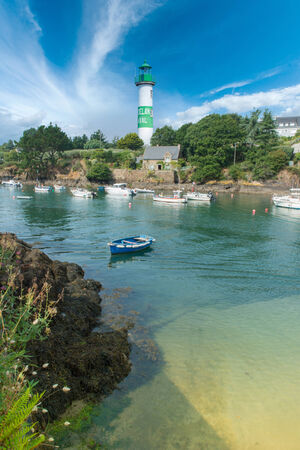Beautiful Briton landscape with a lighthouse on a sunny day photo