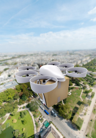 future technology: 3D rendering of a commercial drone carrying a box flying above a city center