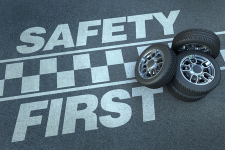 3D rendering of wheels on top of a race circuit with the words safety first Stock Photo