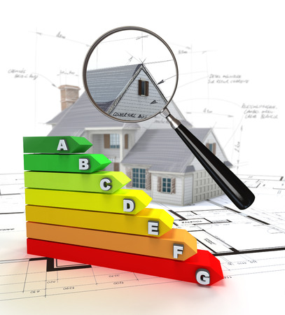 House model, with a magnifying glass and an energy efficiency chart Stock Photo