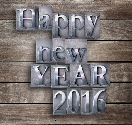 typescript: 3D rendering of the words Happy New Year 2016 written in vintage typescript  on a wood board background Stock Photo