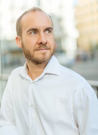 greeneyes: Man on the street with a thoughtful expression Stock Photo