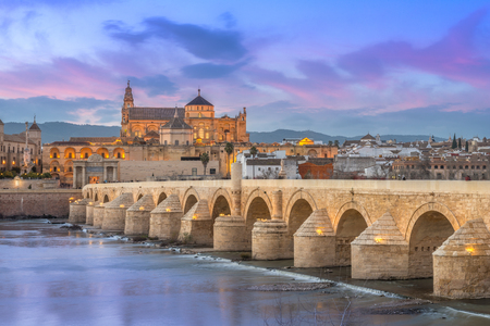 Cordoba, Spain, old town seen from the river at sunset. Banque d'images