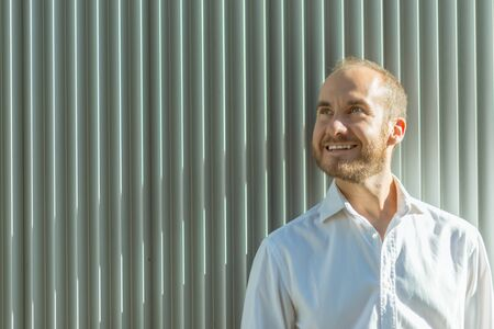 greeneyes: Portrait of a smiling man leaning against a wall of corrugated iron