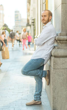 greeneyes: Young man leaning on a wall in downtown Madrid Stock Photo