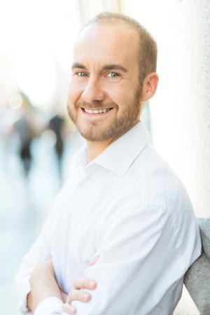 greeneyes: Smiling man on the street Stock Photo