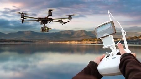 guiding: Hands guiding a drone through a remote control Stock Photo