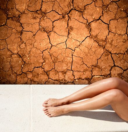 soil texture: sunbathing woman legs lying by a dried up land