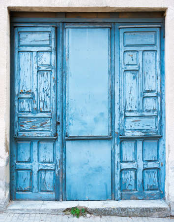 quartered: Old blue door with triple opening