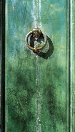 green door: Old green door with an ancient brass knocker Stock Photo