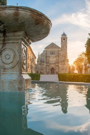 plateresque: Beautiful el Salvador Chapel in Ubeda, Spain, reflected on the fountain water