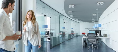 Woman and man having a coffee in a corporate office