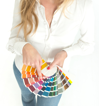 Unknown woman displaying a color swatch sampler Imagens
