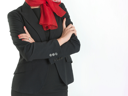 Headless portrait of a hostess with black costume and red foulard